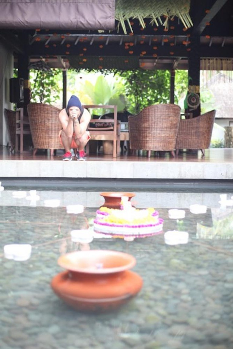 Artist CRUICKSHANK takes pause in the Villa Swara Padi courtyard