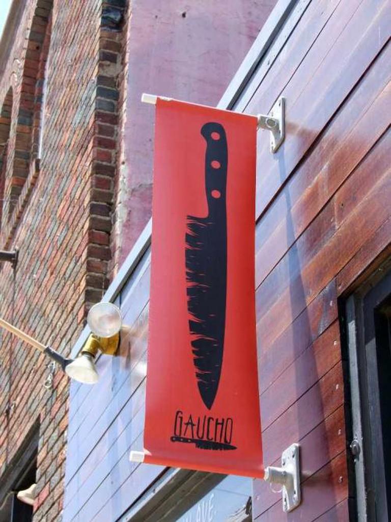 Gaucho restaurant sign.
