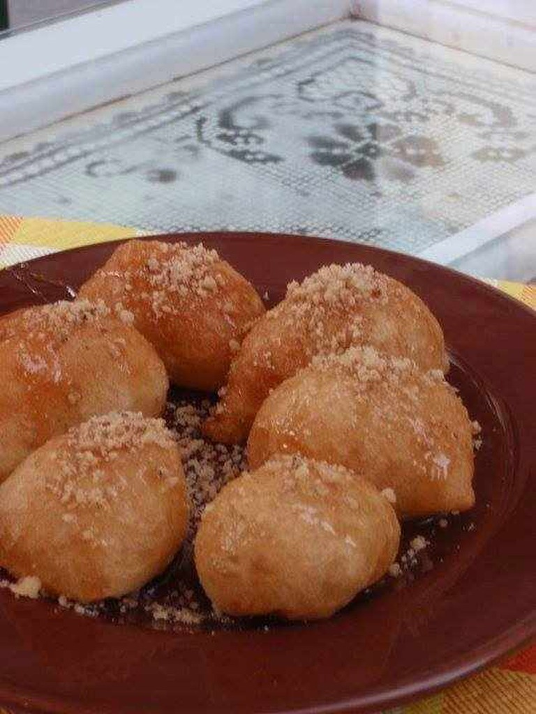 Traditional loukoumades with honey, walnuts and cinnamon | Courtesy of Stazei Meli