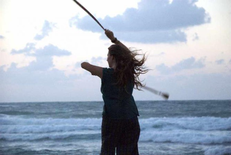 Photo by: Eran Sandler@Flickr Caption: Women using juggling sticks on the shore of Bat Galim