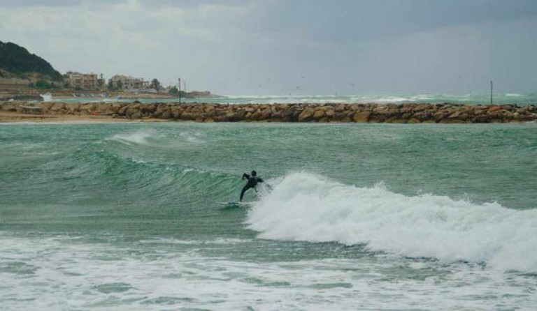 Photo by Morgan Davis@Flickr Caption: Surfer getting a right in Haifa
