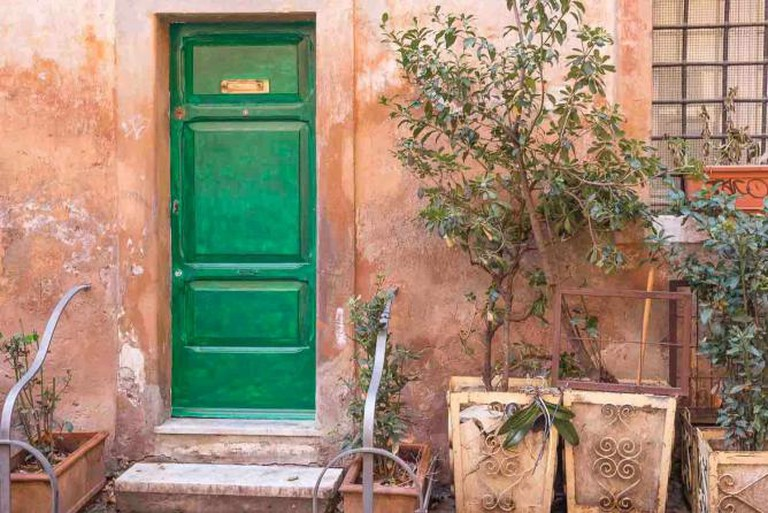 Green door of a house in Trastevere