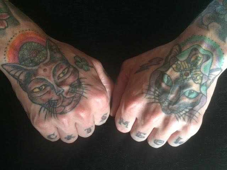 Tattoos. A Siamese version of the diety KuanYin and a Burmese Buddha