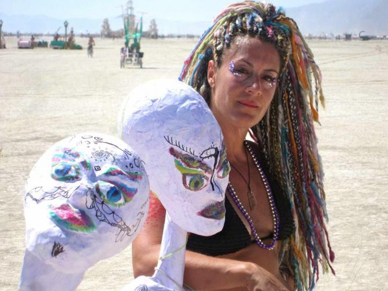 Burning Man: Stacy Gebhardt Posing With Art l © Stacy Gebhardt