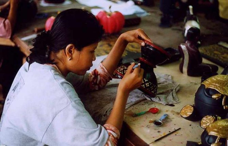 Woman working on Cambodian handicraft