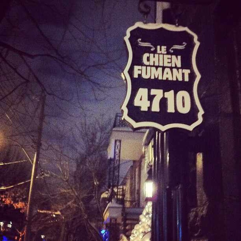 Sign for Le Chien Fumant Restaurant, Montreal