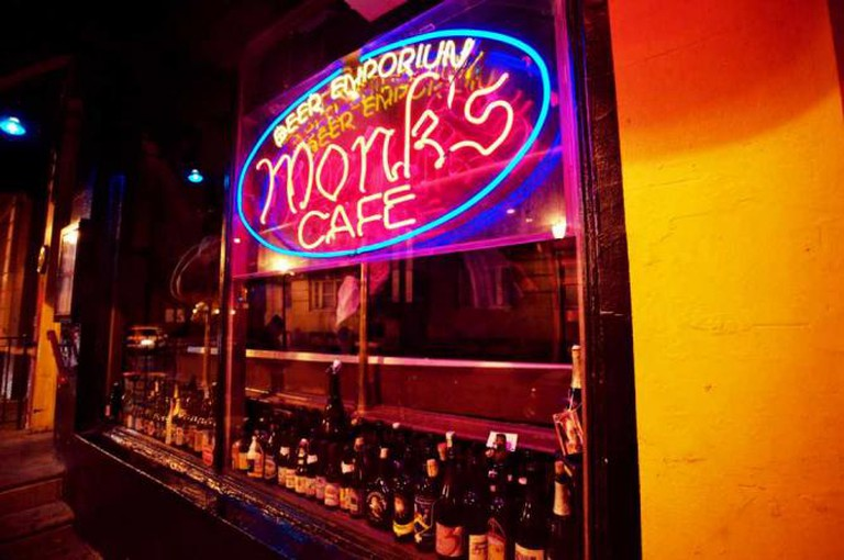 The glowing sign for Monks Cafe is seen through their front window at 16th and Spruce in Rittenhouse, Philadelphia.