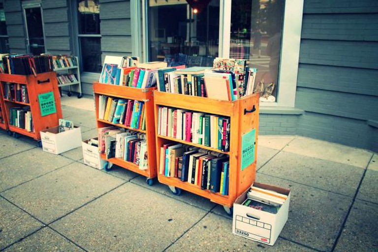 An outside sidewalk sale of books at Second Story Books and Antiques.