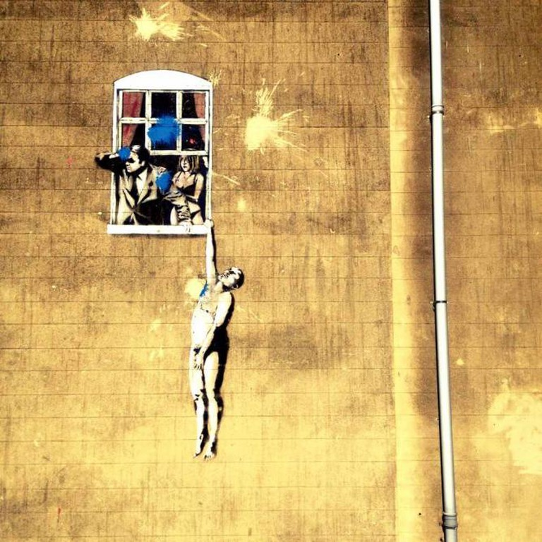 One of Banksy's world-famous pieces of street art in Bristol