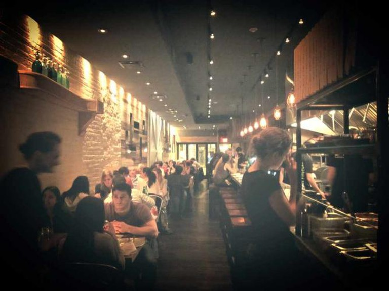 Diners share conversations and meals at the small, intimate restaurant in Midtown Village.
