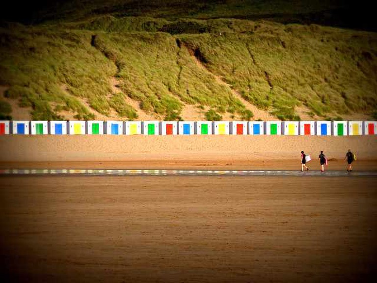 The colourful beach houses on Woolacombe beach