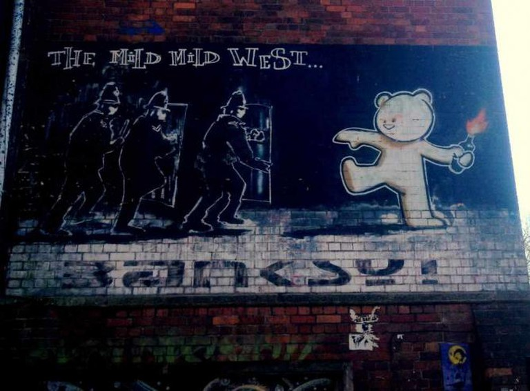 Banksy's 'Mild Mild West' mural in Stokes Croft | Courtesy of Marianna Hunt