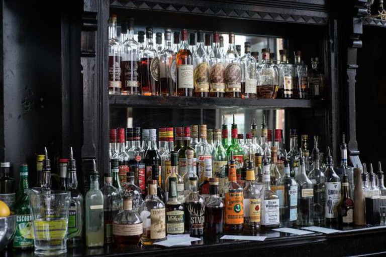 A shot of the variety of liquor at the bar of Scofflaw.