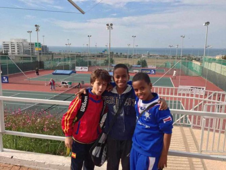 Three boys at the Selma and Irving Ettenberg Israel Tennis Center in Haifa | © Courtesy Israel Tennis Centers