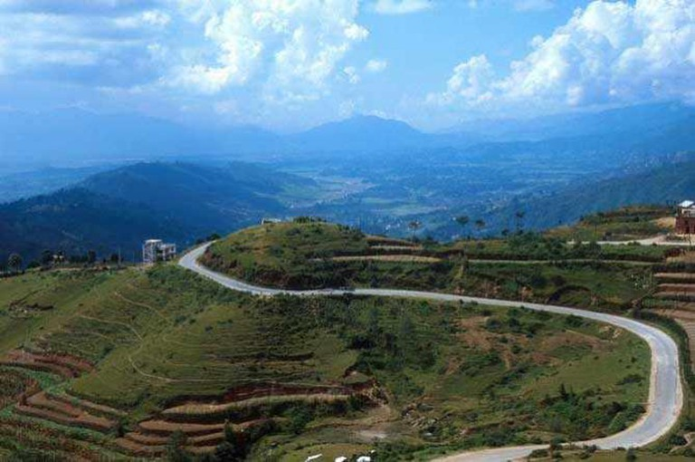 Narrow winding road leads through extremely diverse terrain in Nepal.