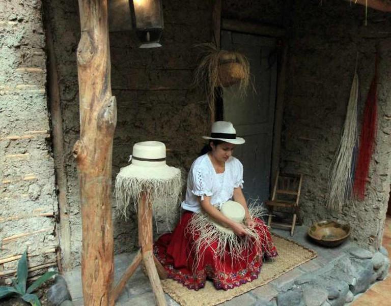 "Woman weaving a ""Panama Hat"""