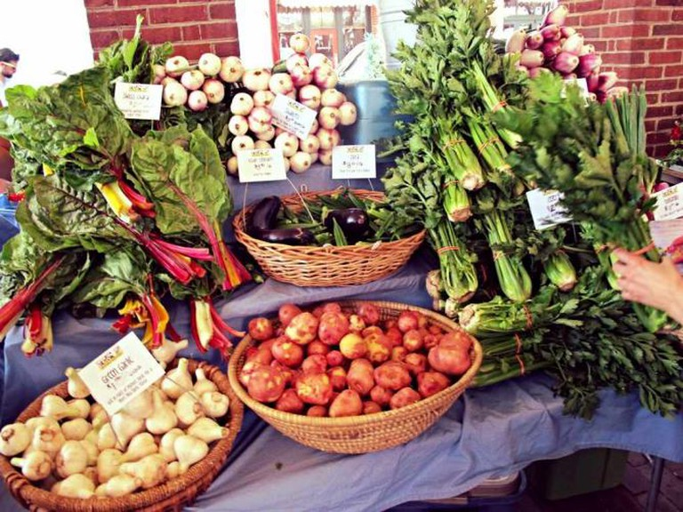 Fresh, locally-sourced produce sits on a vendor stand at Headhouse Market.