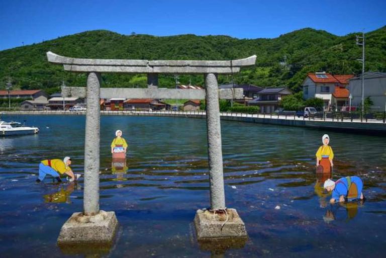 Stone torii in the bay in front of Yurahime Shrine.