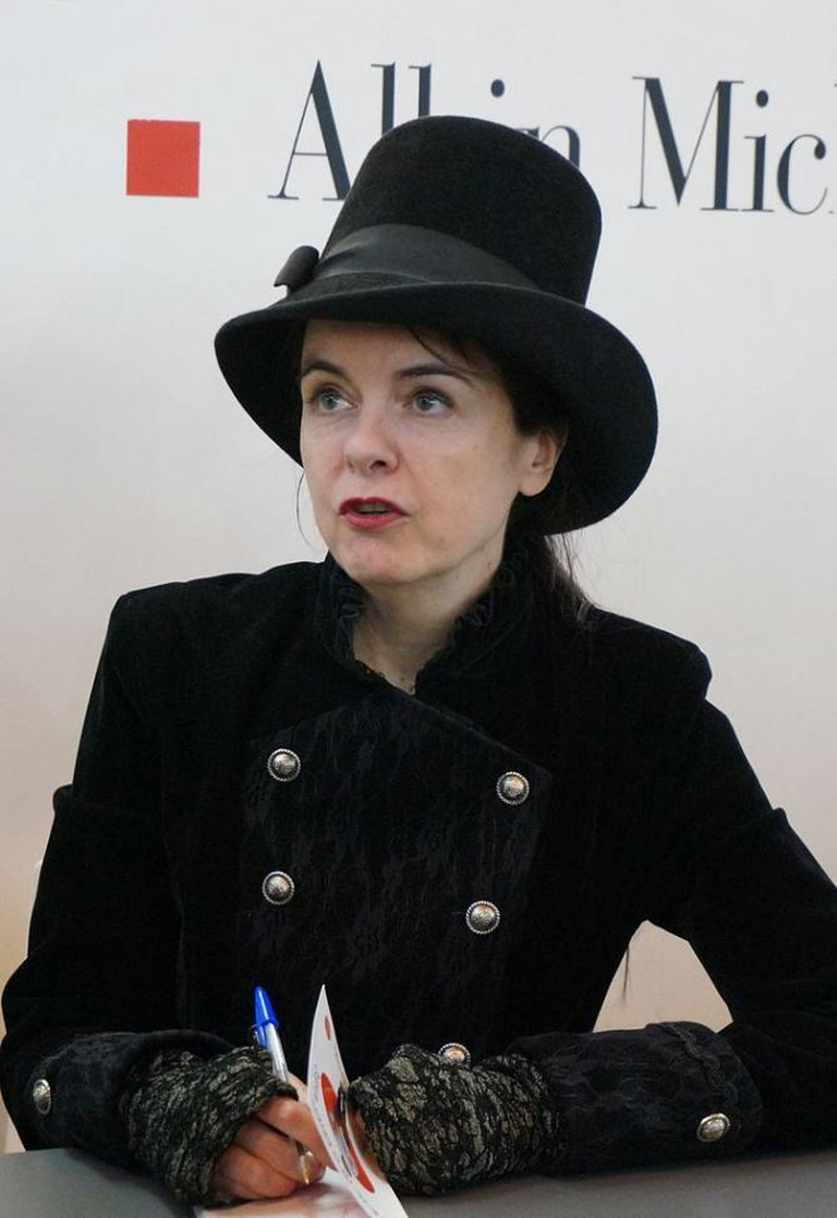 Amélie Nothomb with her distinguishable big hat and black clothes I
