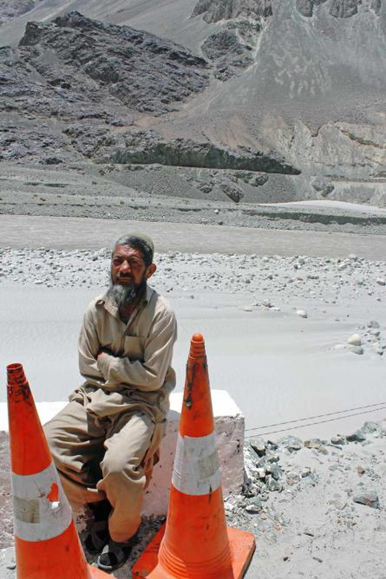 Construction worker sitting on the side of the road, Turtuk
