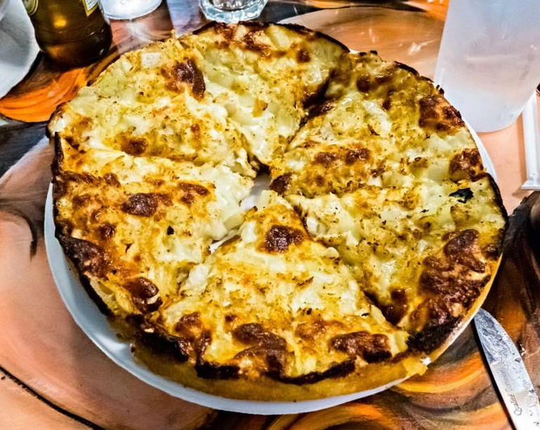 The specialty crab pizza at Matthew's Pizza is one of the best in the city.