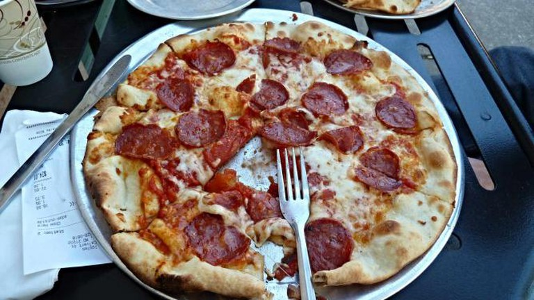 A classic pepperoni pie which is often eaten with a fork and knife and Iggy's.