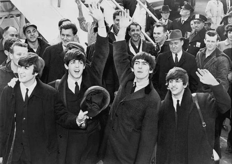 The Beatles wave to fans after arriving at Kennedy Airport, 1964 | © United Press International/WikiCommons