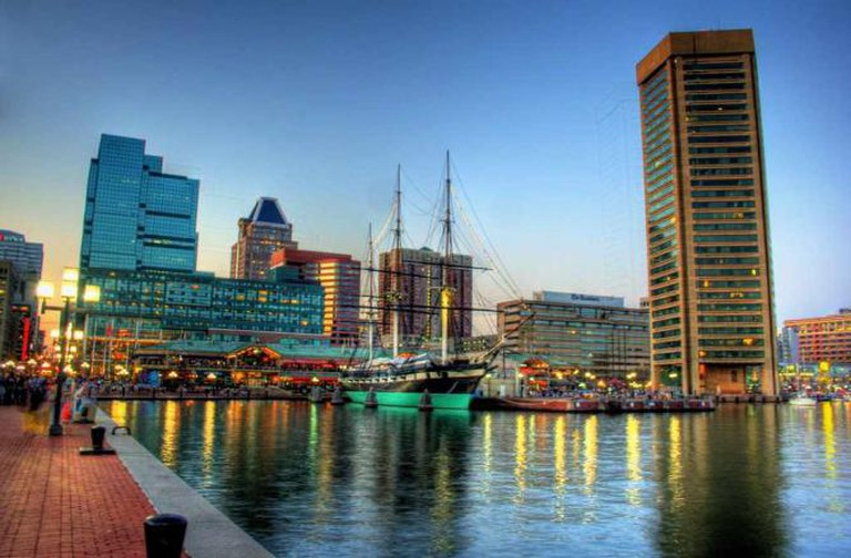 The Inner Harbor of Baltimore's Patapsco River where many restaurants line the shore and piers.