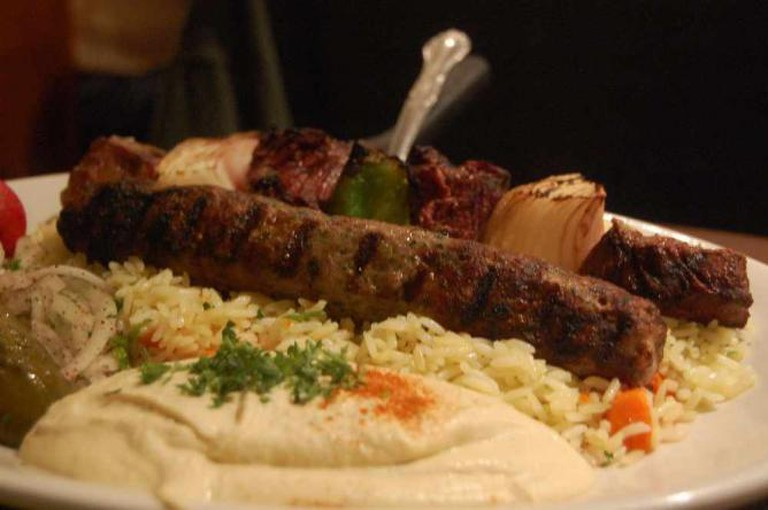 Grilled meat and hummus, staples of Lebanese cuisine