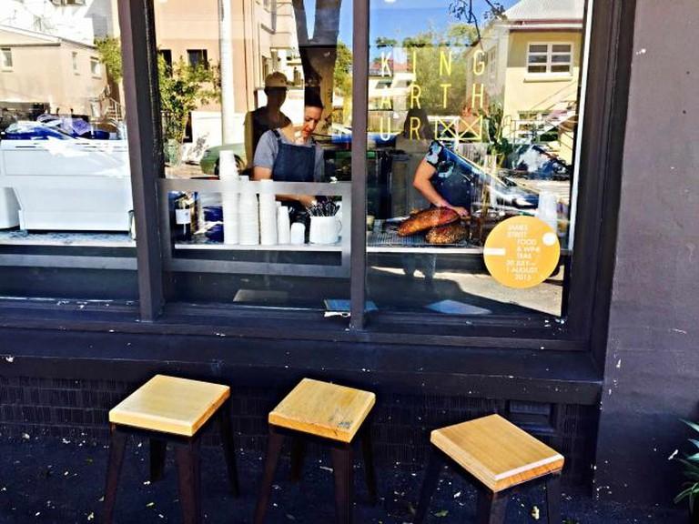 Outdoor seating area at King Arthur Café | © Mona Mizi