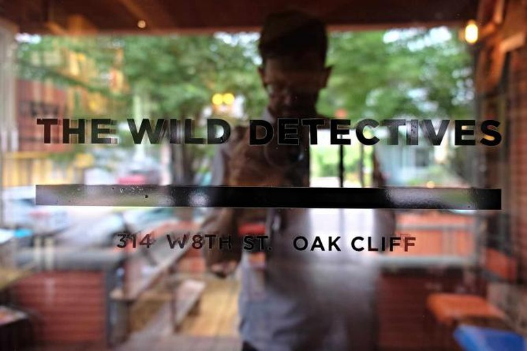 The front window of Dallas' The Wild Detectives shop is shown in the Oak Cliff section of the city.
