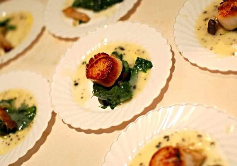 A plating of the seared sea scallops by Chef Tre Wilcox at Abacus.