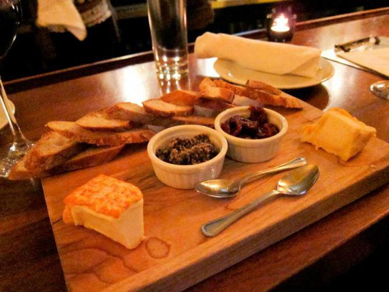 Tria Cafe's cheese board with mustarda and dried cherries.