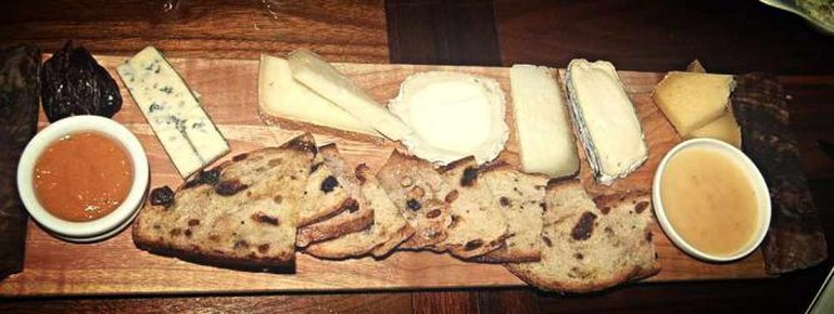The cheese board with an assortment of cheeses and accouterments at Proof Restaurant.