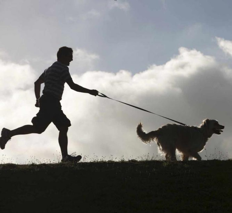 Man Running With Dog | Courtesy of MensFitness