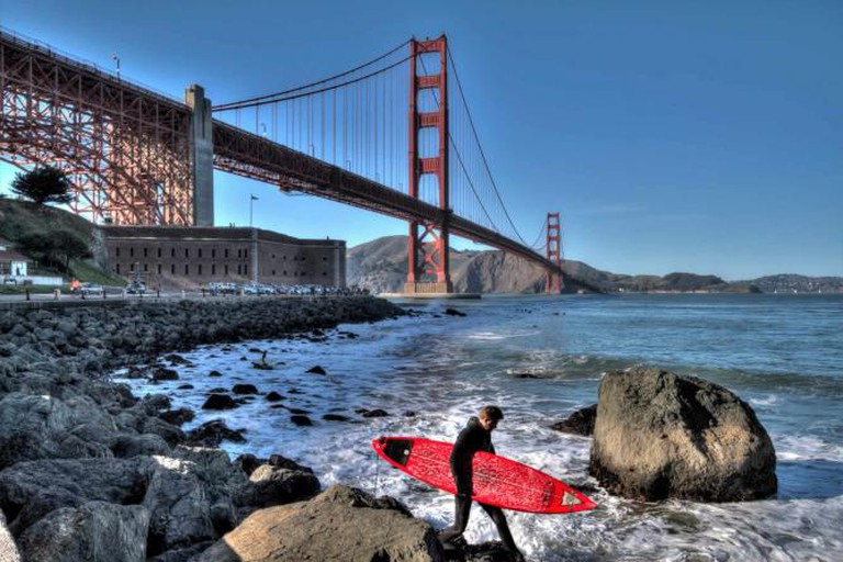 A surfer enters the water at Fort Point | © Andrew E. Larsen/Flickr