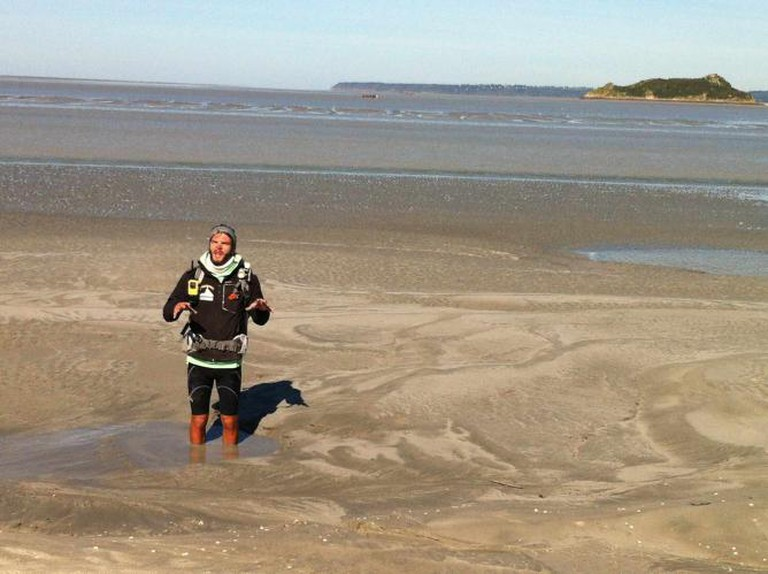 Guide in quicksand demonstration on Bay walk | Courtesy of Hayley Ricketson