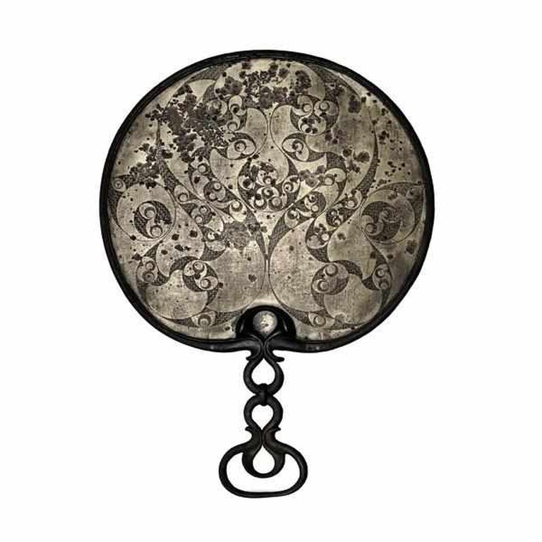 http://www.britishmuseum.org/explore/highlights/highlight_objects/pe_prb/d/decorated_bronze_mirror.aspx
