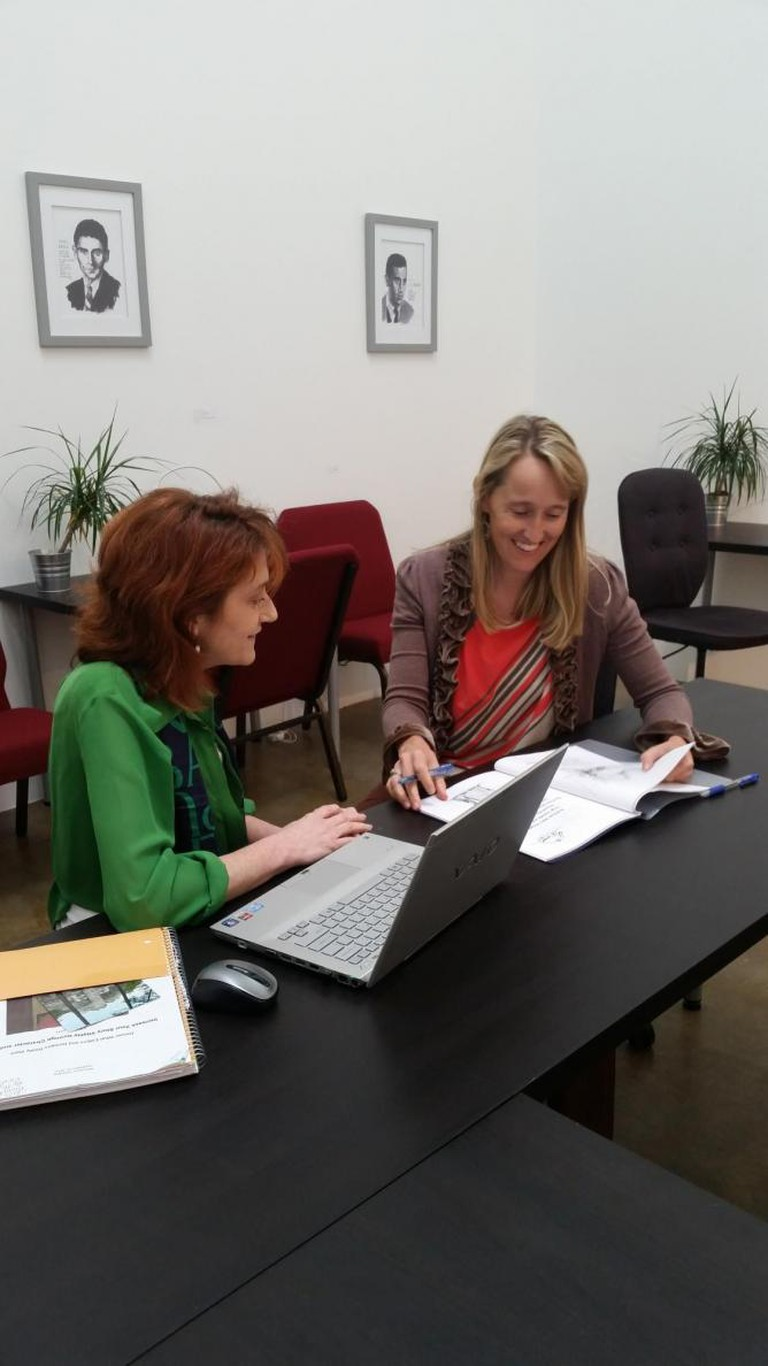 White-Olsen Giving A One-On-One Consultation To Fellow Writer   © Writespace