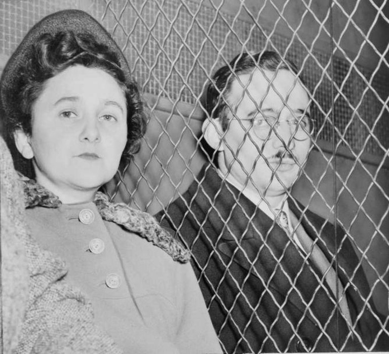 Julius and Ethel Rosenberg, separated by heavy wire screen as they leave U.S. Court House after being found guilty by jury