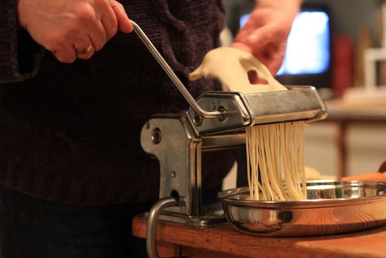 A pasta machine in use