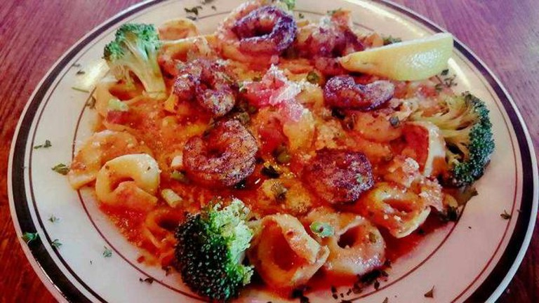 Creole seasoned shrimp over a bed of tortellini | Courtesy of Stone Eagle Tavern