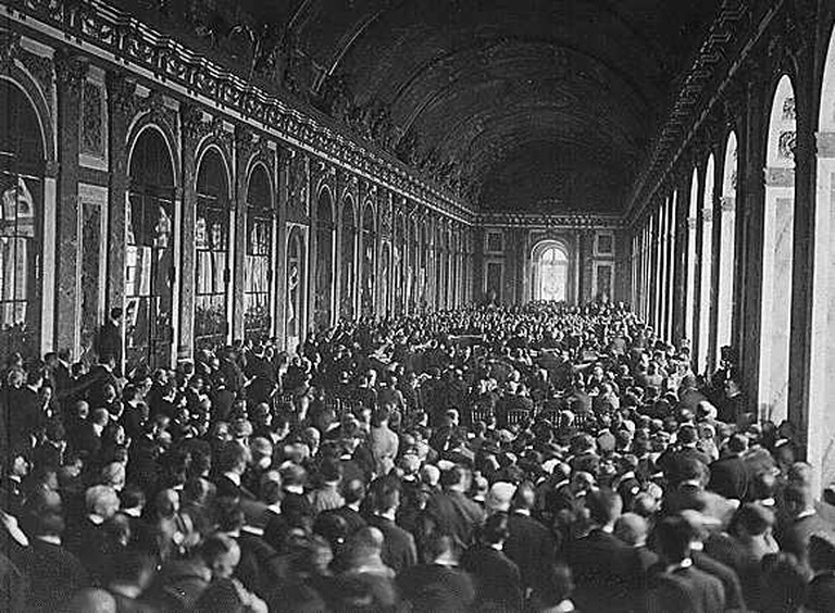 The delegations signing the Treaty of Versailles in the Hall of Mirrors. Photo from 1919