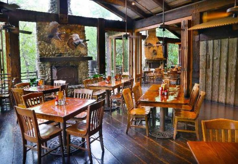 Interior of Gristmill River Restaurant | Courtesy of Gristmill River Restaurant