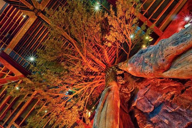 A giant faux redwood dominates the center of Clifton's © Ryan Tanaka