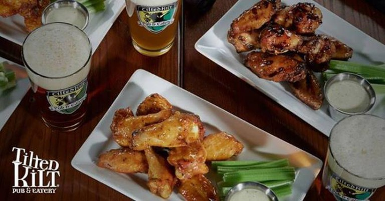 Wings and beer | Courtesy of Tilted Kilt