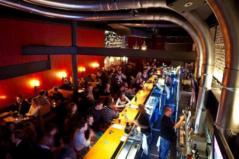 interior of ChurchKey bar with the bartenders serving a great deal of patrons