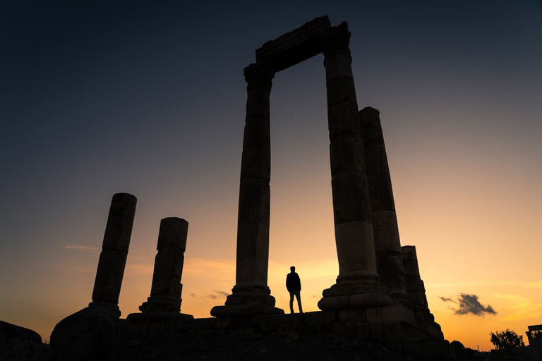 Amman Citadel, Ancient Roman architecture and city on top of mountain in Amman at sunset, Jordan