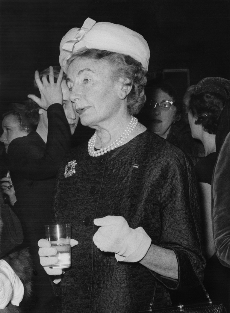 Fashion editor Carmel Snow attends a function in London, 1956