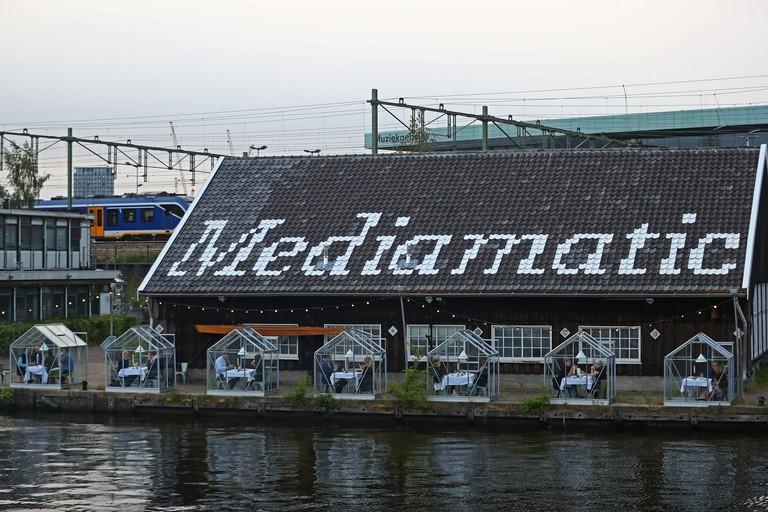 Customers enjoying the Quarantine Greenhouses at Mediamatic ETEN, Amsterdam